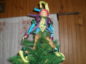 Decorative monkey on top of christmas tree