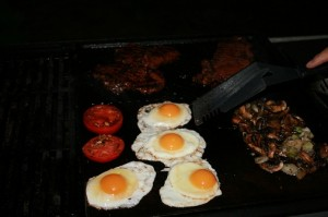 4 eggs and some tomatoes on a bbq